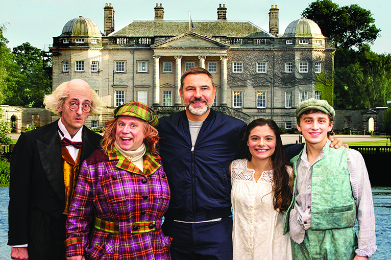 Cast of Awful Auntie with David Walliams outside stately home
